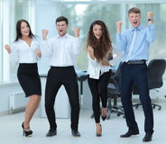 Successful business people looking happy and confident. Successful and confident business team celebrating win Royalty Free Stock Images