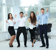 Successful business people looking happy and confident. Successful and confident business team celebrating win Royalty Free Stock Image