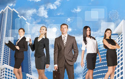 Successful business people in suits, smiling Royalty Free Stock Photo