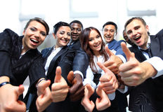 Successful business people with thumbs. Up and smiling Royalty Free Stock Photography