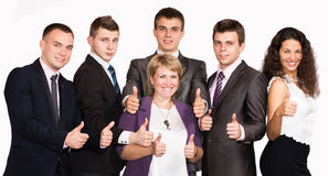 Successful business people with thumbs up and Stock Images