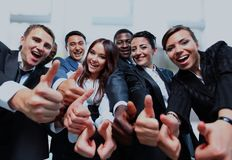 Successful business people with thumbs up and smiling. Successful business people with thumbs up and smiling Stock Photos