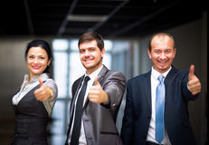 Successful business people with thumbs up Stock Photography