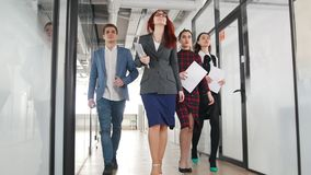A successful business people walking through the corridor stock video footage