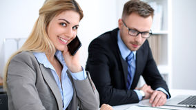Successful business people working at meeting in office background stock photo