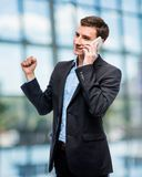 Successful business on the phone, businessman in a suit talking Stock Images