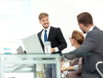 Successful business presentation of a man at the office Royalty Free Stock Photos