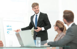 Successful business presentation of a woman at the office. Group of happy and successful business people looking confident stock image