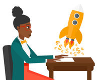 Successful business sturt up. An african-american successful woman sitting at the table and looking at a rocket with money taking off the paper vector flat Stock Image
