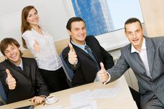 Successful business team. Showing thumbs up Stock Photos