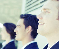 Successful business team. Close-up shot of three business people standing looking in same direction Stock Image