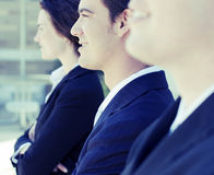 Successful business team. Head and shoulders of three business people looking in same direction smiling Royalty Free Stock Photos