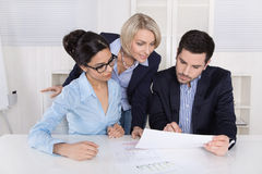 Successful business team - academics with female senior manager. Trainees with her boss discussion and analysing Stock Photo