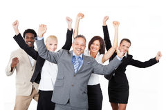 Successful Business Team With Arms Raised Over White Background Stock Photos