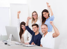 Successful Business Team With Arms Raised Royalty Free Stock Photo