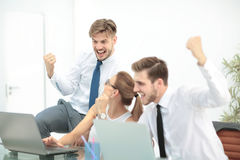 Successful business team with arms up at the office Stock Photography