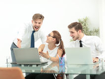 Successful business team with arms up at the office Royalty Free Stock Photo