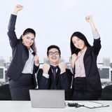 Successful business team celebrating with arms up Royalty Free Stock Images