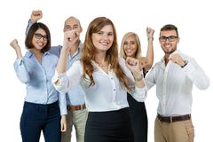 Successful business team cheering. Successful business team of diverse young executives standing cheering and celebrating their success with an attractive young Royalty Free Stock Photo