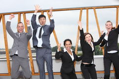 Successful business team cheering and rejoicing Royalty Free Stock Photos