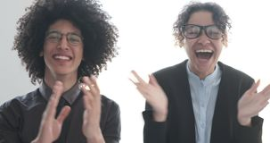 Successful business team clapping hands. And celebrating at office stock video footage