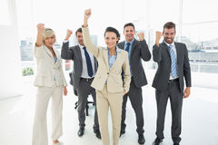 Successful business team clenching fists in office Stock Image