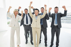 Successful business team clenching fists Stock Image