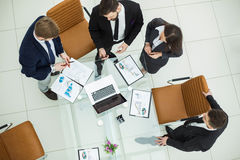 Successful business team discussing marketing graphics at a working meeting Stock Photo