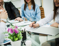 Successful business team discussing a new contract at the workpl Royalty Free Stock Photos