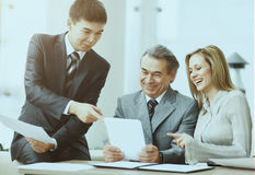 Successful business team discussing work plan using a tablet Royalty Free Stock Images