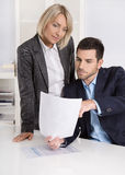 Successful business team: Female boss talking with her colleague Stock Photography