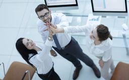 Successful business team giving each other a high five . Professional business team giving each other a high five stock image