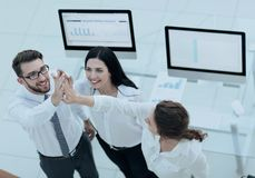 Successful business team giving each other a high five . Professional business team giving each other a high five royalty free stock photo