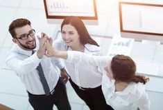 Successful business team giving each other a high five . Professional business team giving each other a high five stock images