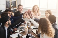 Successful business team is giving high five royalty free stock image