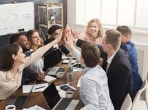 Successful business team is giving high five stock images