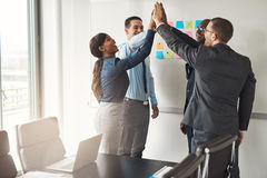 Successful business team giving a high fives Stock Photo