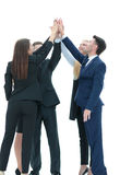 Successful business team giving a high fives gesture as they lau Stock Images