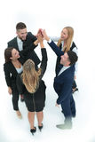 Successful business team giving a high fives gesture as they lau Royalty Free Stock Photos