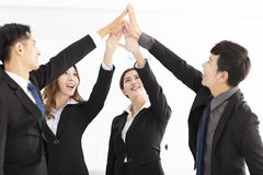 Successful business team giving a high fives gesture. Successful asian business team giving a high fives gesture royalty free stock photo