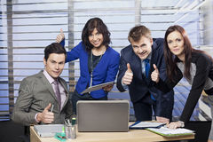 Successful business team giving thumbs up Royalty Free Stock Image