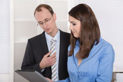 Successful business team - good teamwork under man and woman. Royalty Free Stock Photography