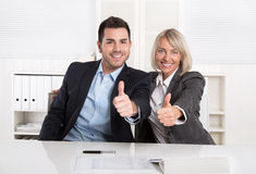 Successful business team or happy business people making recomme. Successful male and female business team or happy businesspeople making recommendation gesture Stock Photos