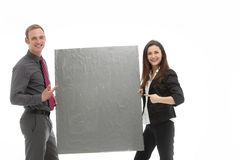 Successful business team holding blank board Stock Images