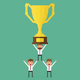 Successful business team holding trophy. Teamwork concept. Royalty Free Stock Photo