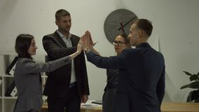 Successful business team joining hands together stock video footage