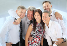 Successful business team laughing together Stock Photo