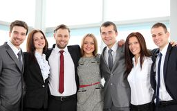 Successful business team laughing together. Closeup portrait of a successful business team laughing together royalty free stock photos