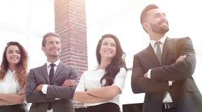 Successful business team looking at copy space stock images