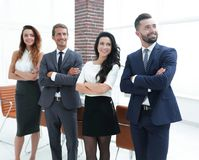 Successful business team looking at copy space Stock Image